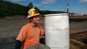 LIUNA member Tim Norgren Locked Down to a barrel full of set cement on railroad tracks at Arc Logistics
